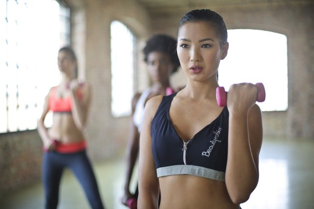 women exercising new to group fitness